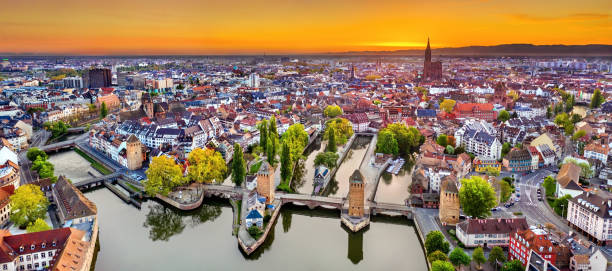 Covered bridges and Petite France in Strasbourg Ponts Couverts Bridges and historic quarter Petite France in Strasbourg at sunrise strasbourg stock pictures, royalty-free photos & images