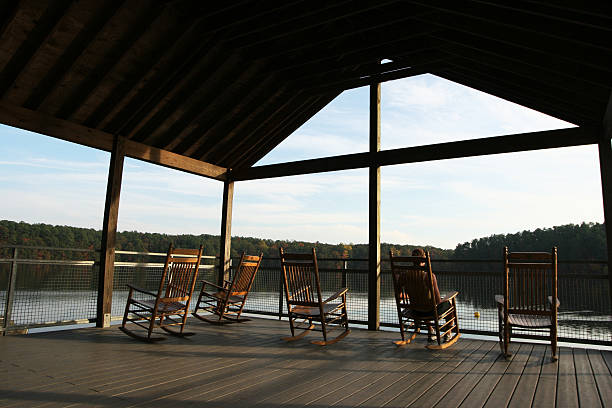 Covered deck on the lake stock photo