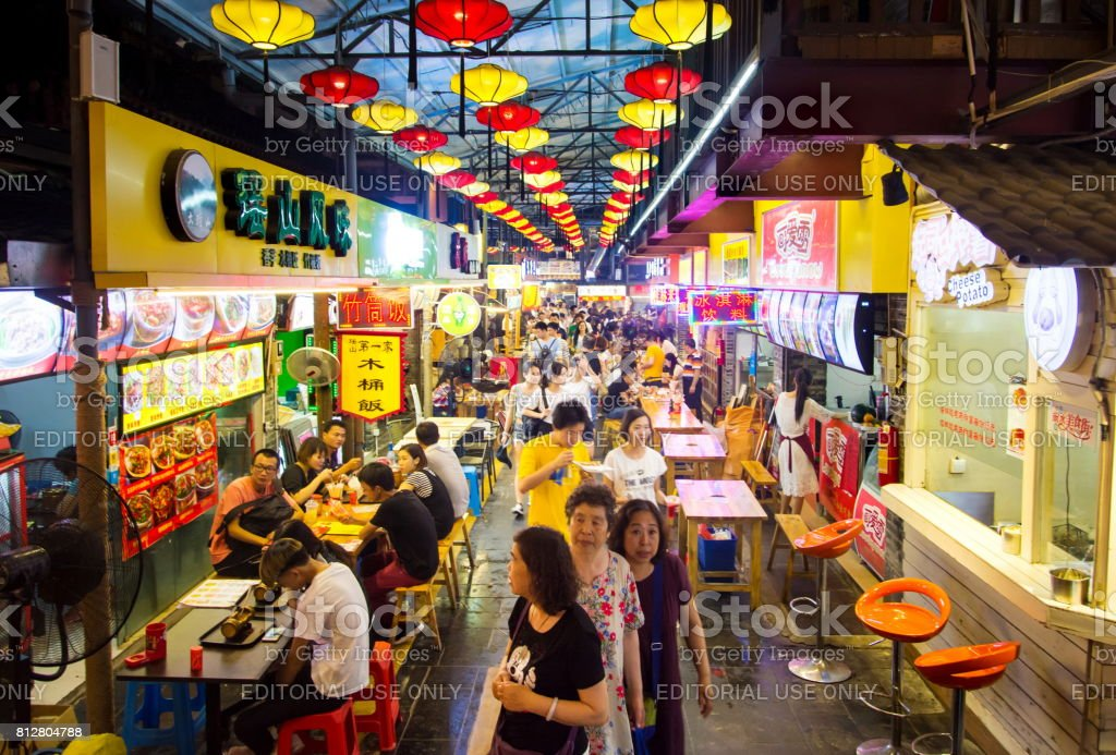 Covered food and delicatessen street in Guilin, full with people stock photo