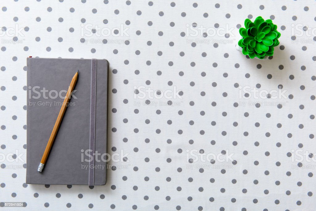Covered grey diary at table stock photo