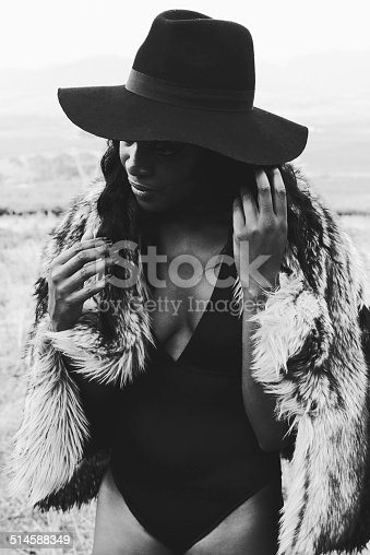 Monotone shot of an attractive young woman posing on the beach