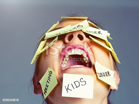 1138361116 istock photo Covered in reminders of things to do, woman freaks out! 525040616
