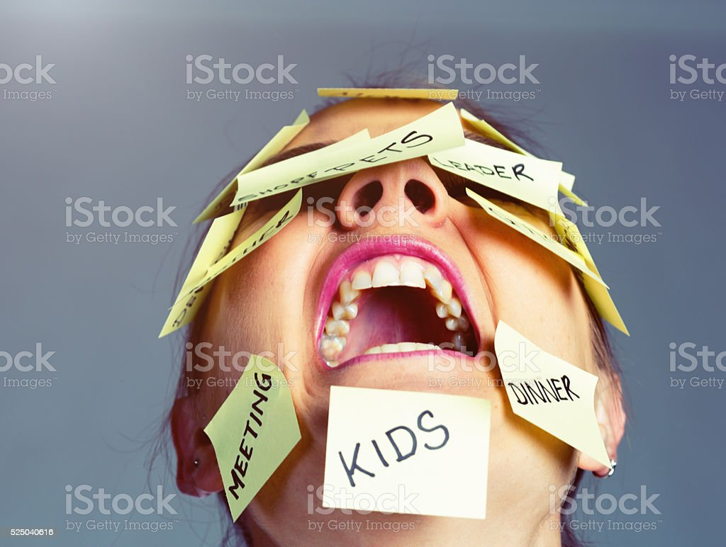 Covered in reminders of things to do, woman freaks out! stock photo