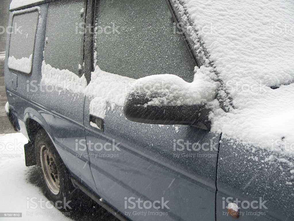 SUV covered in snow royalty-free stock photo