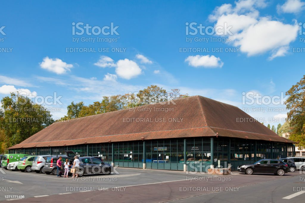 Covered market in L'Isle-Adam L'Isle-Adam, France - September 09 2020: Covered market (known as La Halle) near the town hall in the city center. Architecture Stock Photo