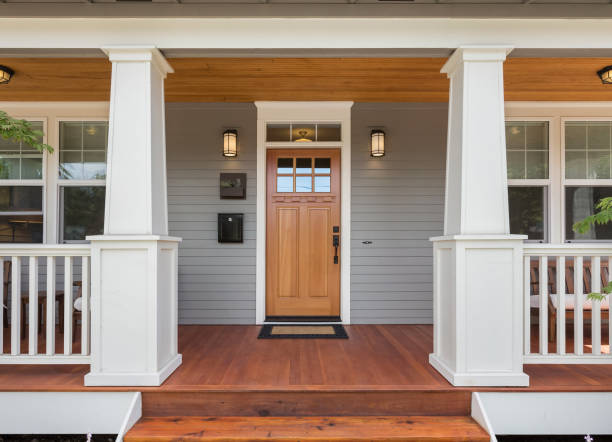 Covered porch and front door of beautiful new home Facade of home with covered porch and door doorway stock pictures, royalty-free photos & images