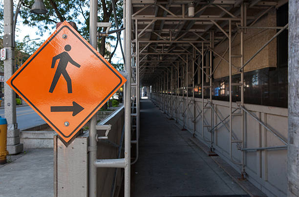 Covered Scaffolding Over Pedestrian Walkway stock photo