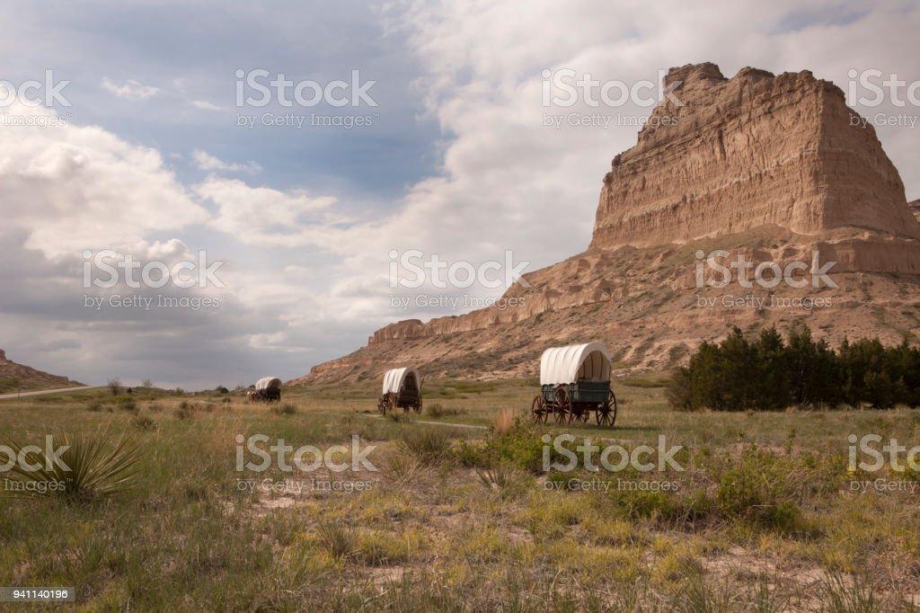 Covered wagons Oregon Trail Scotts Bluff National Monument prairie yucca Nebraska stock photo