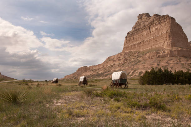Covered wagons Oregon Trail Scotts Bluff National Monument prairie yucca Nebraska stock photo