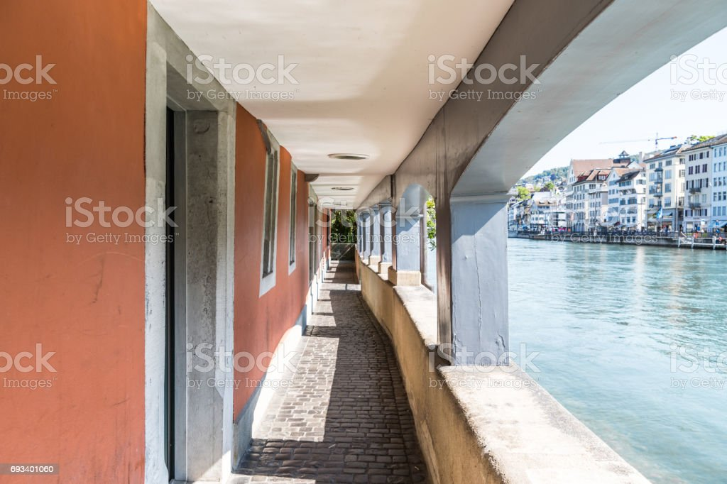 Covered walkway in Zurich by river stock photo
