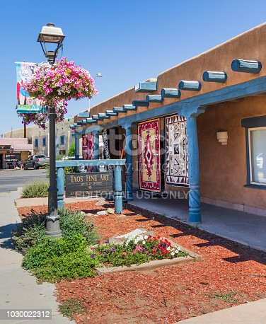 Taos, NM, USA-8 July 18:  A covered walkway at the shop called Taos Fine Art is on the corner of Kit Carson Road and Paseo del Pueblo Norte.