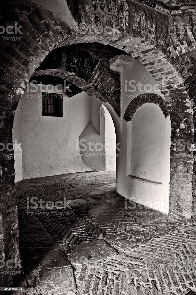 Covered walkway through the Alcazar in Seville, Spain royalty-free stock photo