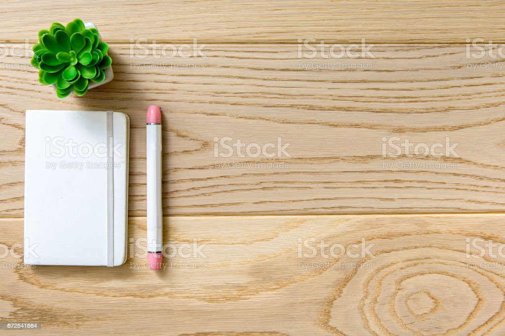 Covered white diary at table stock photo