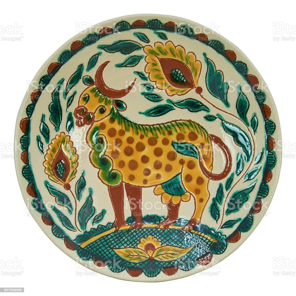 Covered with glaze ceramic plate handmade stock photo