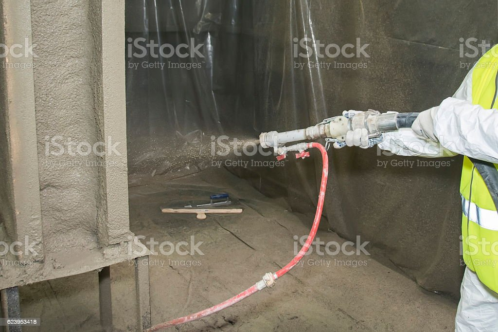 Covering a surface by refractory composition. stock photo