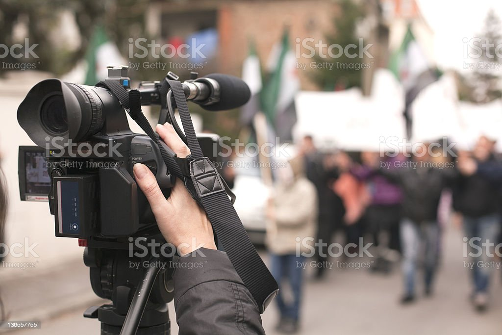 Covering an event with a video camera stock photo