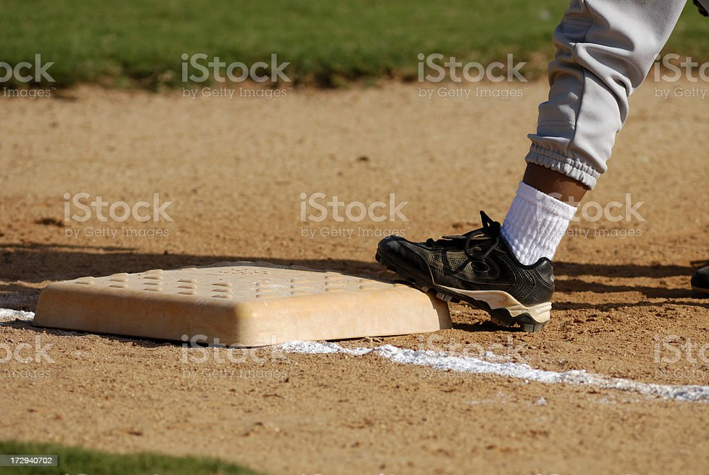 Covering base at t-ball game stock photo