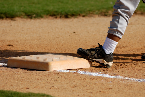 Covering Base At Tball Game Stock Photo - Download Image Now