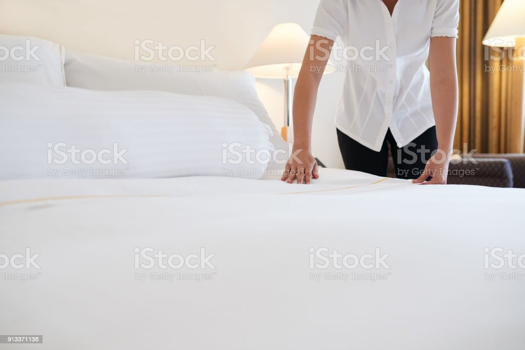 Covering bed with blanket stock photo