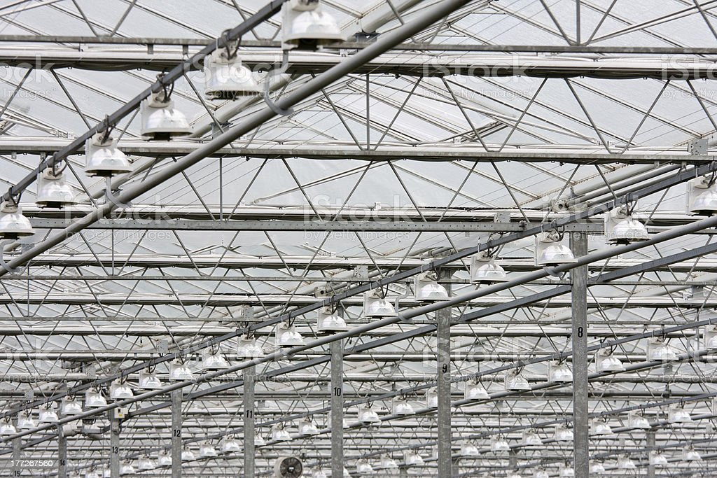Covering of a big glass greenhouse in the Netherlands royalty-free stock photo