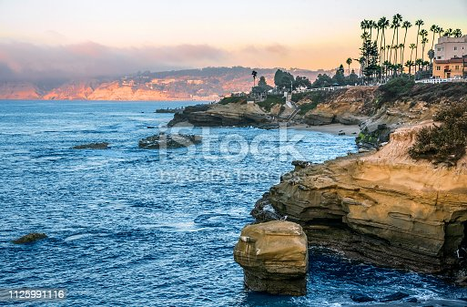 La Jolla is a hilly seaside community within the city of San Diego, California, United States occupying 7 miles (11km) of curving coastline along the Pacific Ocean.