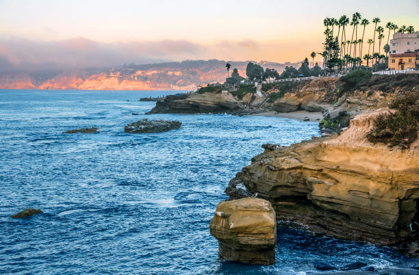 Coves at La Jolla La Jolla is a hilly seaside community within the city of San Diego, California, United States occupying 7 miles (11km) of curving coastline along the Pacific Ocean. bay of water stock pictures, royalty-free photos & images