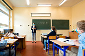 istock Covid-19. A teacher explains epidemic prevention knowledge at a school 1224920711