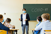 istock Covid-19. A teacher explains epidemic prevention knowledge at a school 1224920805