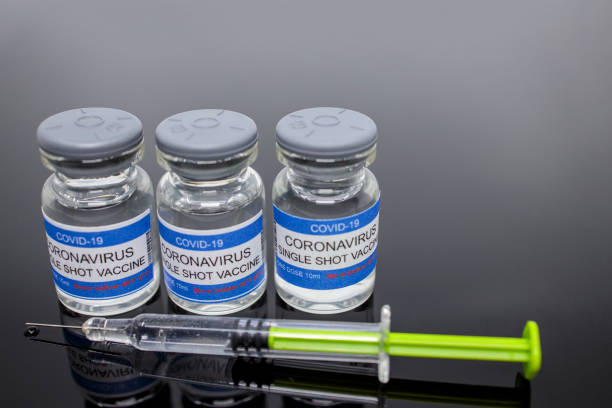 Covid-19, CoronaVirus drug vaccine vials, medicine bottles, syringe injection. SARS-CoV-2 Vaccination, immunization, treatment to cure Covid 19 Corona Virus infection. Medical concept. Copy space. stock photo