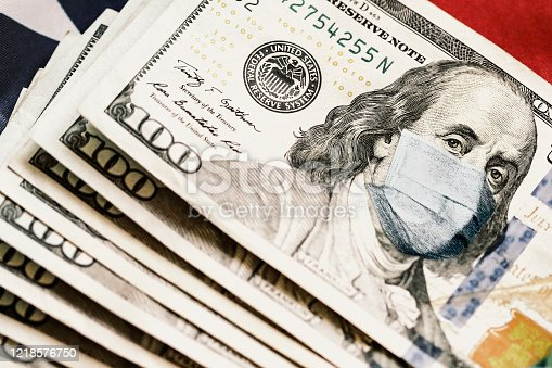 Close up of 100 US Dollar banknote with Benjamin Franklin wearing a protective mask (Covid-19 crisis concept).