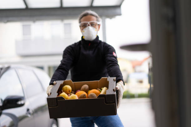 covid-19 fresh healthy fruits delivery at private door stock photo