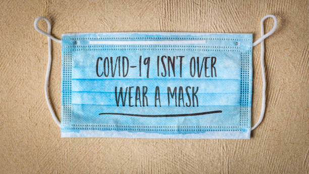 covid-19 is not over, wear a face concept stock photo