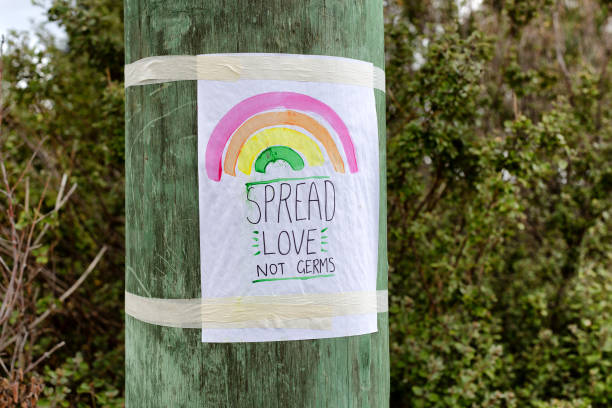 Covid-19 Message about spreading love not germs stock photo