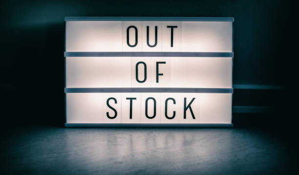 Covid-19 OUT OF STOCK store lightbox sign showing text message for shortage of PPE medical supplies. Coronavirus panic hoarding led to sold out shelves. shortage of hand sanitizer, mask products stock photo