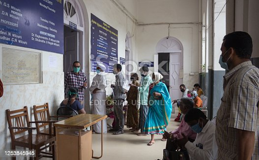 People waiting in queue to get the primary health check up for the Covid19 Corona virus at a dedicated wing of the Krishnaraja Hospital in Mysore of Karnataka state in India.