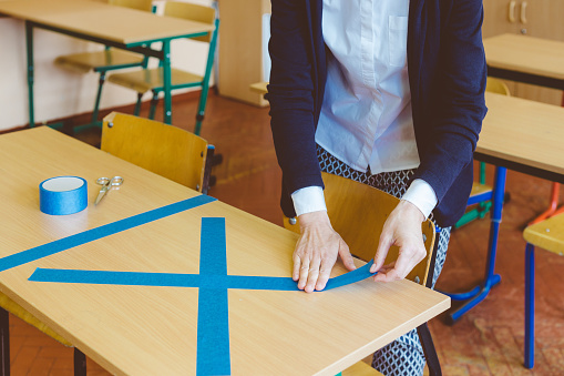 Covid19 The Teacher Marks Empty Sits In The Classroom Stock Photo - Download Image Now
