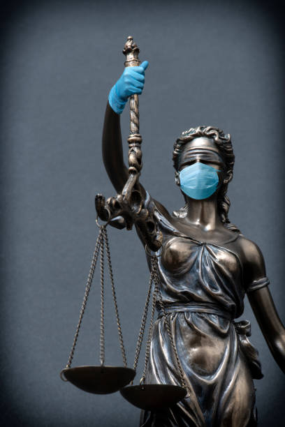 Covid-19 type of Coronavirus epidemic and labor law. stock photo