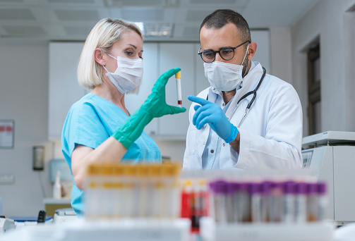 Covit19 Concept Laboratory Technicians Making Blood Tests In Hospital Stock Photo - Download Image Now