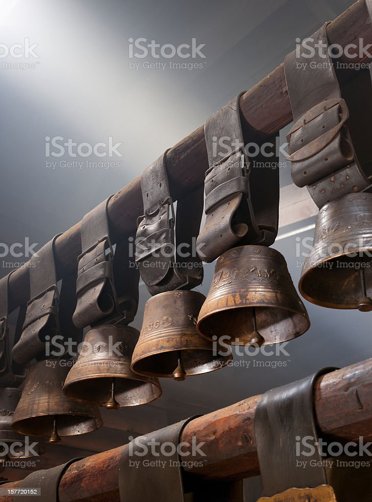 cow bells hanging on roof beam stock photo