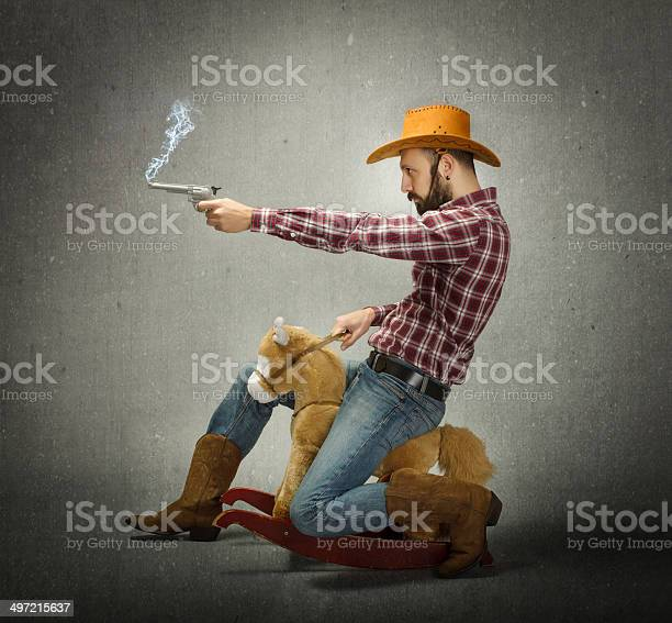 Cow boy with gun in a fake rodeo picture id497215637?b=1&k=6&m=497215637&s=612x612&h=gi53r2ywvtf6ml6mwoqlkh6t5ix7dk4e5ueqksbrkfw=