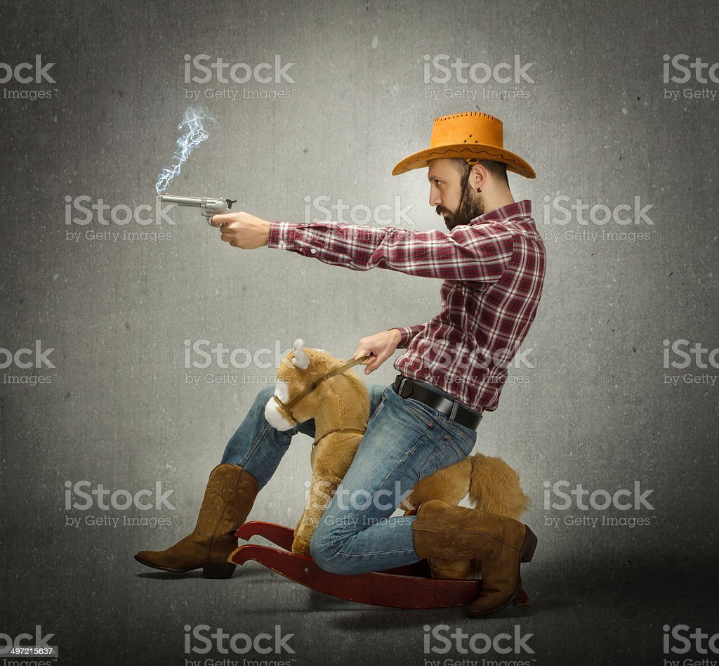cow boy with gun in a fake rodeo stock photo