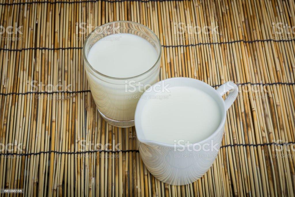 Cow milk and ceramic jug royalty-free stock photo