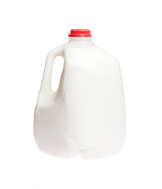 Cow milk Gallon jug of cold cow milk on white isolated gallon stock pictures, royalty-free photos & images