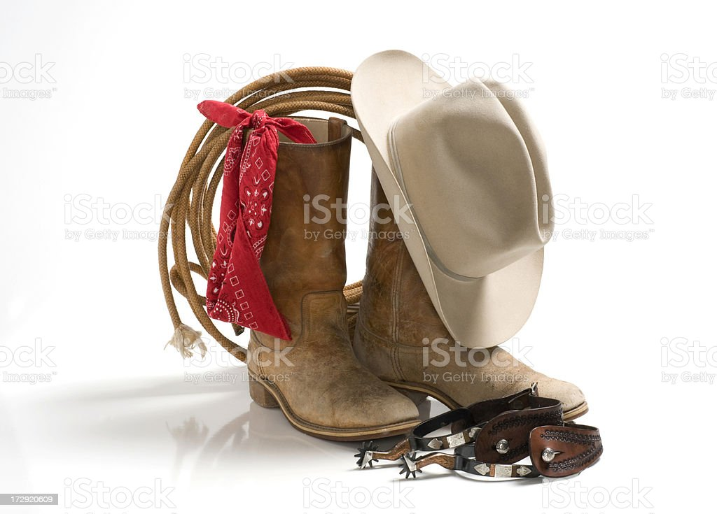 Cowboy accessories, hat,boots,spur,rope,bandana-isolated on white royalty-free stock photo