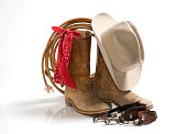Cowboy accessories, hat,boots,spur,rope,bandana-isolated on white