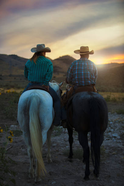 Cowboy and Cowgirl at Dusk stock photo