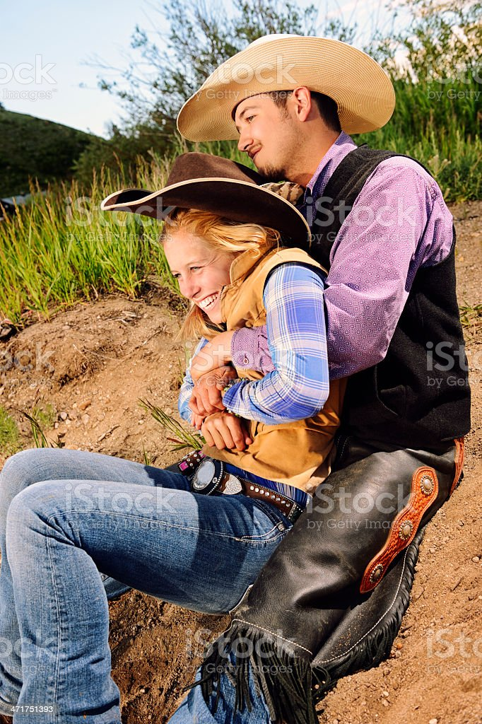 Cowboy and Cowgirl Sweethearts In A Happy Embrace royalty-free stock photo
