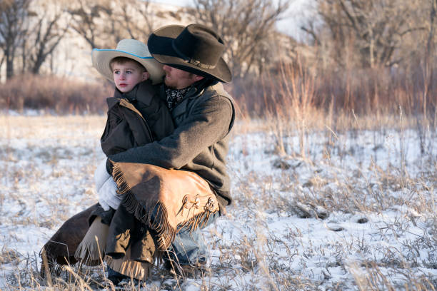 cowboy and his son - montana western usa stock pictures, royalty-free photos & images