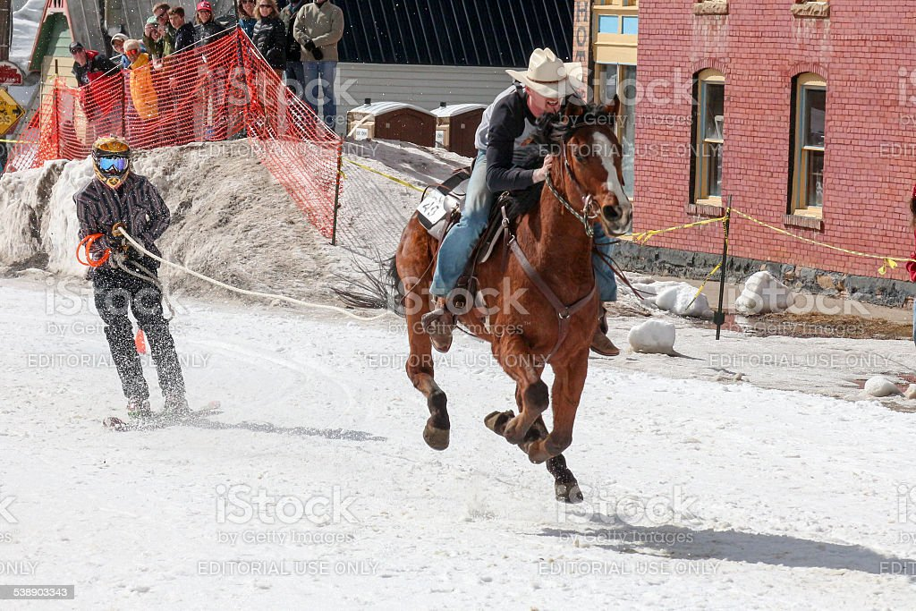 Cowboy and skier in a skijoring competition in Silverton, CO stock photo