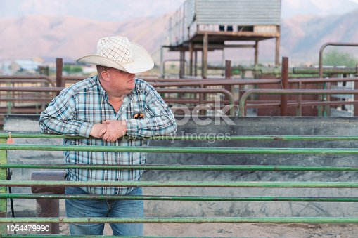 Cowboy standing at the rodeo gate looking over. Real Rodeo People Portrait. Spanish Fork, Utah, USA.